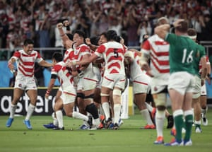 As the final whistle sounds, Japan players celebrate a rousing victory after a stunning second-half display saw off Ireland at Shizuoka Stadium Ecopa.