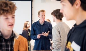Fidoe, centre, talks to prospective students at the new university's open day last month.