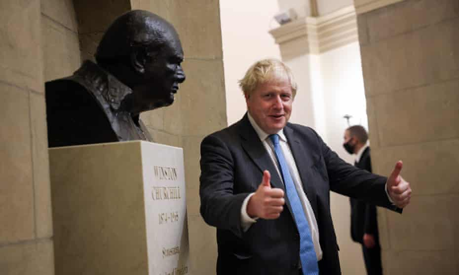 Boris Johnson poses next to a bust of Winston Churchill at the US Capitol last month