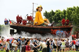 The little girl Giant, an enormous marionette, sits on top of a boat while travelling down Plain Street in Perth during the Perth International Arts Festival on 13 February.