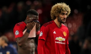 Paul Pogba and Marouane Fellaini leave the field after another difficult evening at Old Trafford.