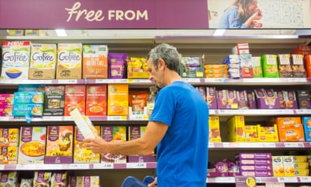 Man at 'free-from' aisle in supermarket