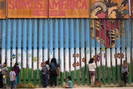Separated families talk through the border fence between the US and Mexico