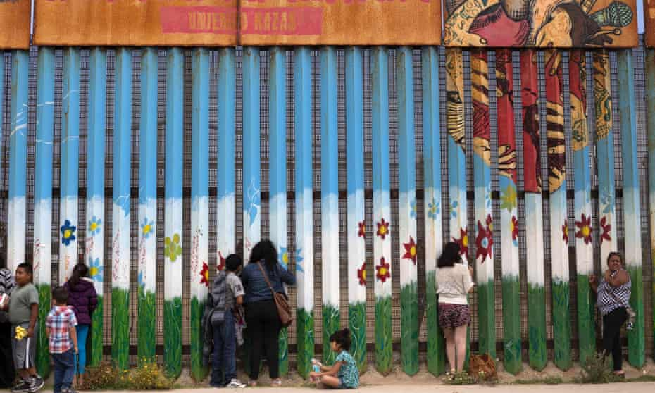 Mexican Americans talk to their relatives through the current border fence – the one that Donald Trump has promised to replace with a wall – between Mexico and the USA.