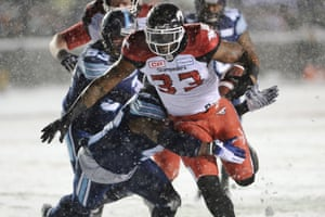 Calgary Stampeders running back Jerome Messam (33) runs the ball for a touchdown against the Toronto Argonauts during first half CFL football action in the 105th Grey Cup Sunday November 26, 2017 in Ottawa.