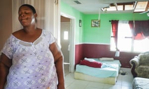 Erica Roberts, 41, a resident of the High Rock area of Freeport, stands inside her home which was destroyed by Hurricane Dorian.