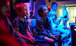 Two boys play video games at Norwich Games Festival, Norwich.