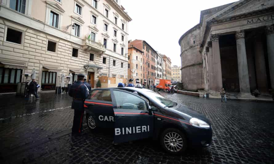 A Carabiniere military police car is parked in front of a bar during an anti-mafia sweep in Rome in 2014