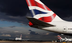 british airways planes taxiing at heathrow with a very dark storm cloud above