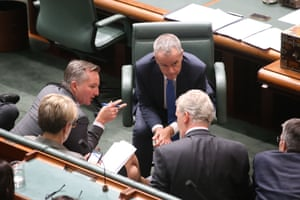 Bill Shorten confers with his front bench during question time