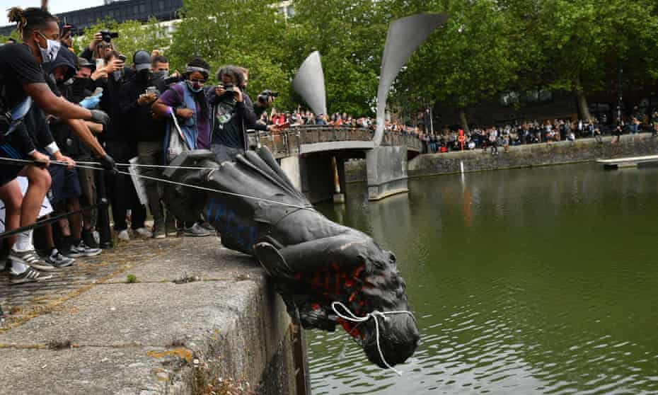 Protesters throw a toppled statue of slave trader  Edward Colston into Bristol harbour, June 2020.