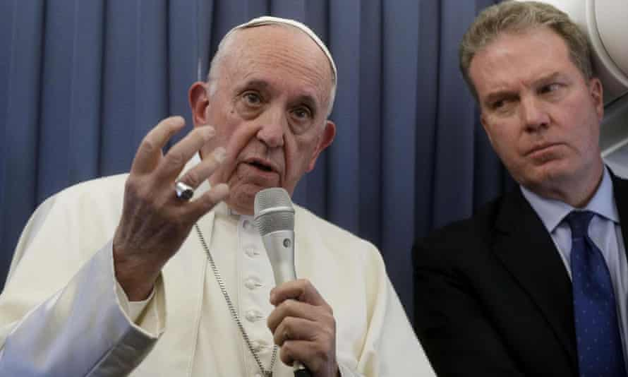 Pope Francis speaks to journalists on the plane from Ireland flanked by Vatican spokesman Greg Burke.