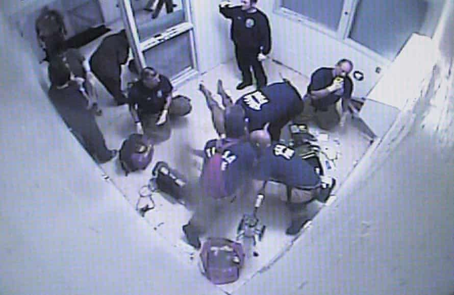 Elliott Williams surrounded by emergency personnel in his cell