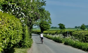 A man cycles in Oxfordshire