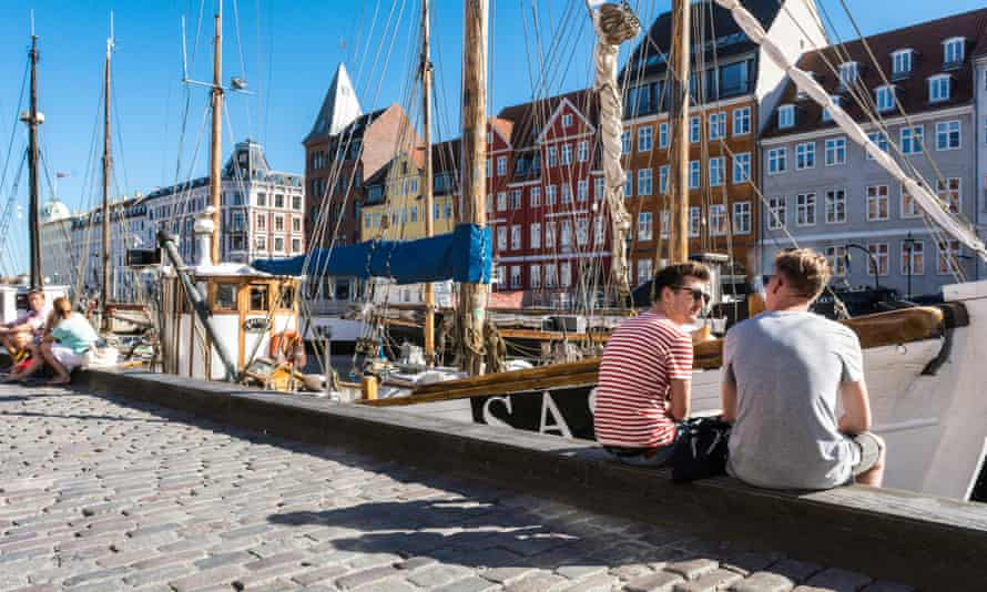 Hotels, restaurants, boats and people in the waterfront district of Nyhavn in Copenhagen