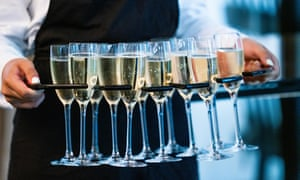 Close Up Of Waitress Serving Glasses Of Champagne At Event