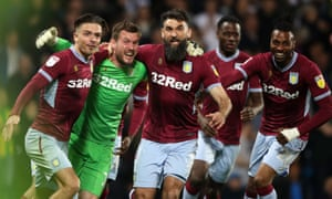 Goalkeeper Jed Steer celebrates with his Aston Villa teammates after saving two penalties in the crucial shootout.