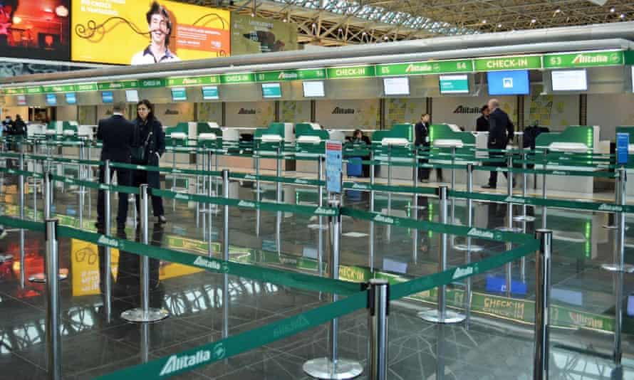 A deserted Alitalia check-in area at Rome's Leonardo da Vinci airport on Friday.