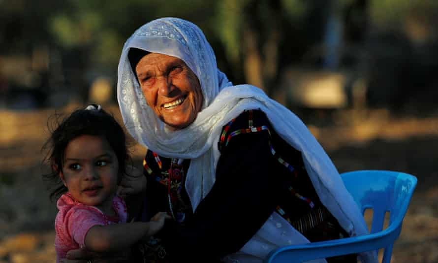 Rashida Tlaib's grandmother, Muftia, with another of her granddaughters in the Israeli-occupied West Bank.