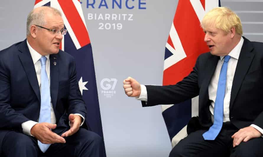 Australian prime minister Scott Morrison speaks with British prime minister Boris Johnson at the G7 summit in Biarritz in 2019