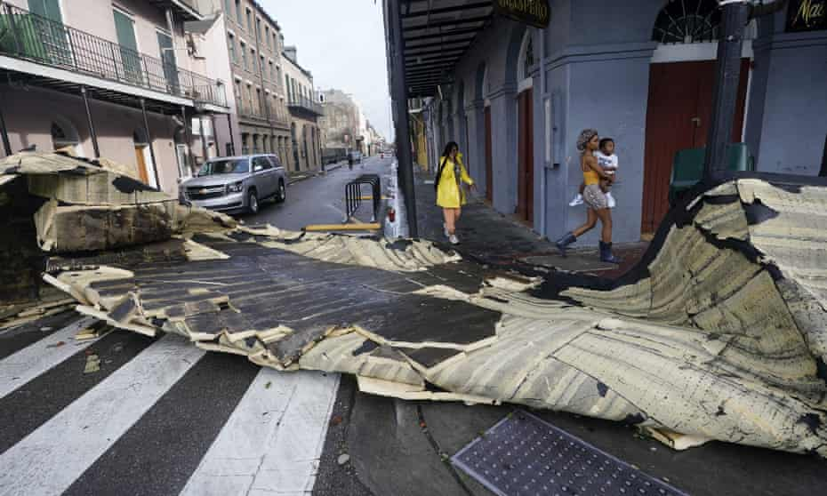 A section of roof that was blown off of a building in the French Quarter by Hurricane Ida blocks an intersection on Monday.