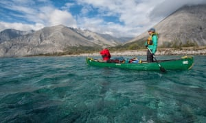 Paddlers float over the aquamarine colours of the Wind River