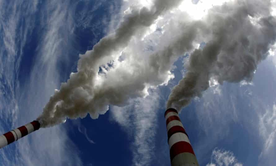 Smoke billows from the chimneys of Bełchatów power station Europe's biggest coal-fired power plant