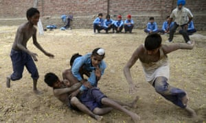 Indian schoolchildren play kabaddi at their school in the village of Sarai Amanat Khan, about 30km west of Amritsar. The 12-nation Kabaddi World Cup kicked off this week.