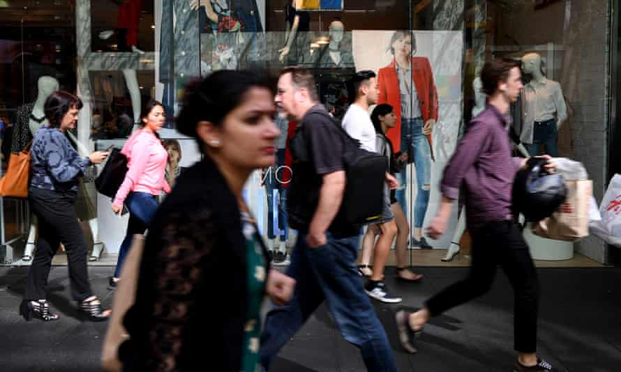 People are seen at Pitt Street mall in Sydney, 6 March 2017.