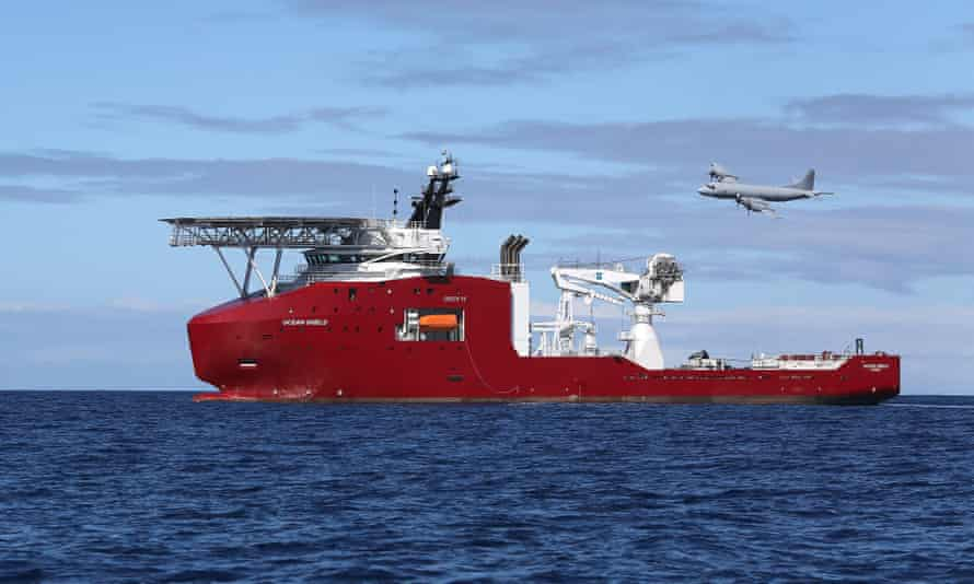 A Royal Australian Air Force AP-3C Orion flies past the Australian vessel Ocean Shield on a mission to drop sonar buoys to assist in the search for MH370.