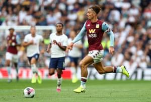 Villa's Jack Grealish surges forward.