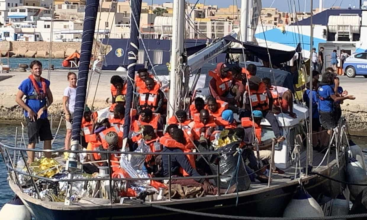 A boat arrives in Lampedusa, Sicily, with refugees rescued off the coast of Libya