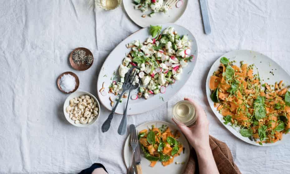 raw carrot and mustard seed salad and raw cauliflower salad