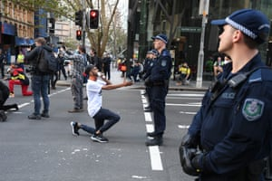 David Dungays nephew Paul Silva reaching towards a police officer.