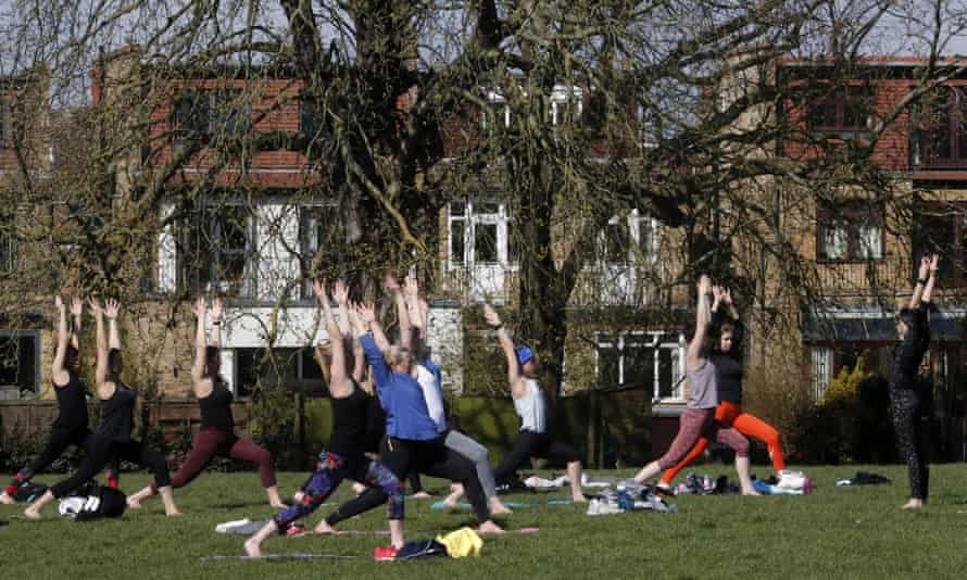 Exercising in a London park after the easing of England's lockdown rules