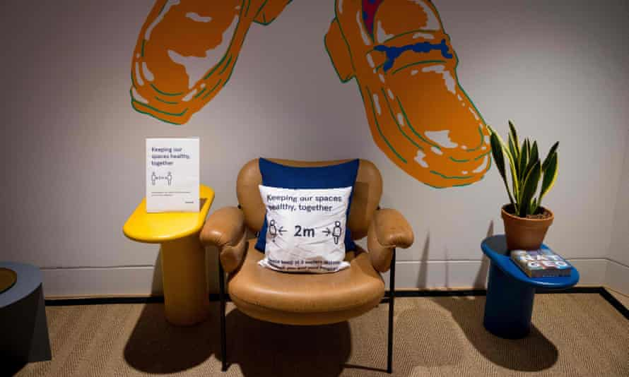 Signage advising people to maintain a two-metre physical distance is seen at a WeWork co-working and office space in the City of London