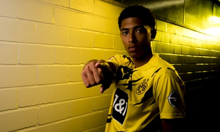 English teenager Jude Bellingham poses after signing a contract with Borussia Dortmund.