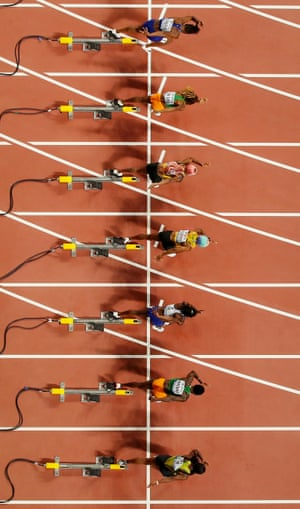 Jamaica's Shelly-Ann Fraser-Pryce, Dina Asher-Smith of Great Britain and Ivory Coast's Marie-Josée Ta Lou start in the women's 100m final at the Khalifa Stadium during the IAAF World Athletics Championships in Doha, Qata.