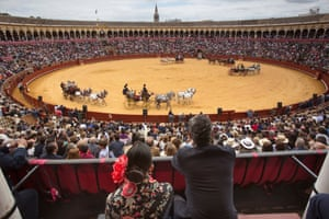 The carriage driving exhibition held at the bullring Real Maestranza on the first day of the fair