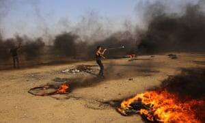 A Palestinian protester using a slingshot to throw stones on the Gaza-Israel border.