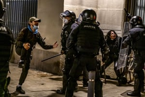 Regional police clash with protesters in Barcelona during a sixth night of protests and riots after the arrest and imprisonment of rapper Pablo Hasél