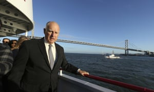 California Gov. Jerry Brown walks to the bow of the high-tech battery-operated San Francisco Bay sightseeing boat, Enhydra, for a cruise of San Francisco Bay, where he signed 16 new laws aimed at easing global warming Thursday, Sept. 13, 2018, in San Francisco.