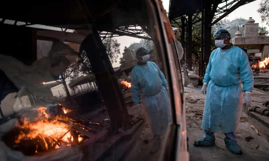 A worker waits to transfer the body of a patient who died of coronavirus at a crematorium in  Delhi.