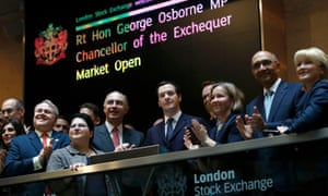 The chancellor, George Osborne, centre, at the London Stock Exchange this June.