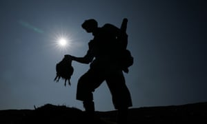 A member of a shooting party carries a brace of grouse on 'the Glorious 12th' of August, 2020.