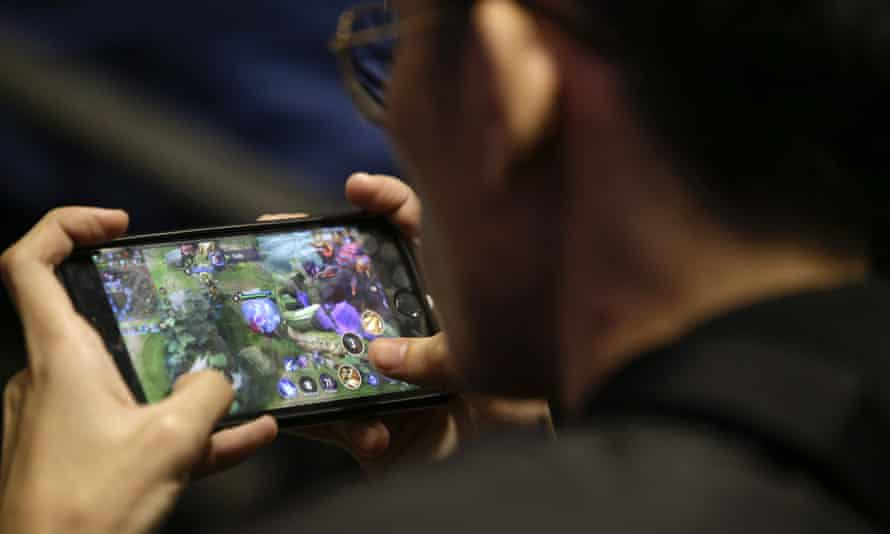 esport player plays on his smartphone
