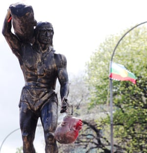 The head of Dagoberto Godoy hangs from a statue of the indigenous Mapuche chieftain Caupolicán after protesters decapitated a statue of the Spanish conquistador in Concepción.