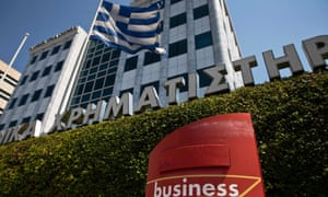 A Greek flag flutters outside the Athens stock exchange which reopens today after a five-week enforced shutdown.