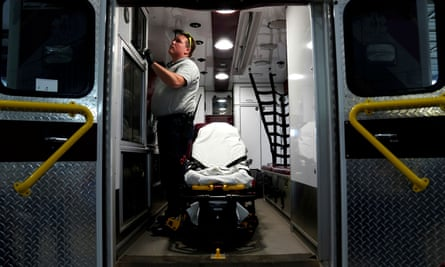 Paramedic Andrew Sherman disinfects an ambulance after transporting a potential coronavirus patient in Shawnee, Oklahoma. The state has not yet implemented a stay-at-home order.