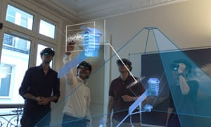 The ScanPyramids team examining an augmented reality review of the newly-discovered void.